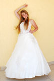 Girl. The happy girl in a wedding dress Royalty Free Stock Photography