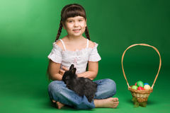 Girl. With a rabbit and a basket with Easter eggs Royalty Free Stock Photography