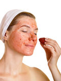 Young woman with fruit mask on her face Royalty Free Stock Images