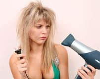 The girl. With a hair drier Stock Photography