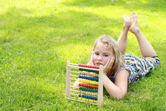 Girl with an abacus Royalty Free Stock Photography