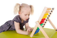 Girl and abacus Stock Images