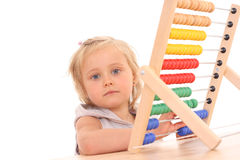 Girl and abacus Stock Photography