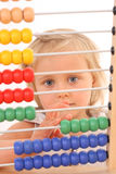 Girl and abacus Stock Image