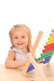 Girl and abacus Royalty Free Stock Photos