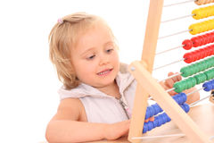 Girl and abacus Stock Photos