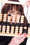 The girl and abacus Royalty Free Stock Photos