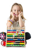 Girl with abacus on white Stock Photo