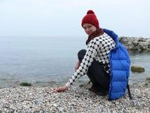 Girl on abandoned beach Stock Photography