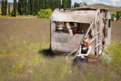Girl and abandoned Caravan Royalty Free Stock Photo