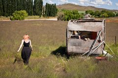 Girl and abandoned Caravan Stock Photo