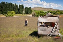 Girl and abandoned Caravan Royalty Free Stock Images