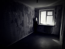 Girl in an abandoned creepy room Stock Photos