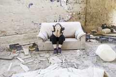 Girl in abandoned house Stock Images