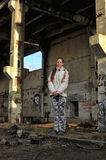 Girl in abandoned industrial building Royalty Free Stock Photo