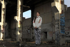 Girl in abandoned industrial building Royalty Free Stock Photos