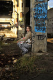 Girl in abandoned industrial building Stock Images