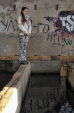 Girl in abandoned industrial building Stock Photo