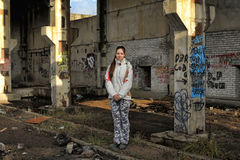 Girl in abandoned industrial building Stock Photos