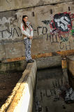 Girl in abandoned industrial building Royalty Free Stock Images