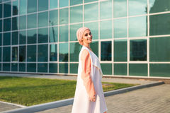 Girl in abaya on the background of the business center Royalty Free Stock Photography