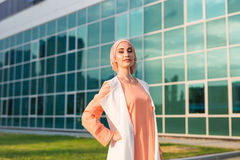Girl in abaya on the background of the business center.  Stock Photo