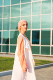 Girl in abaya on the background of the business center.  Stock Photography