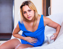 Girl with abdominal pains Stock Photography