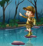 A girl above a rock in the river Royalty Free Stock Image