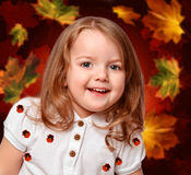 Girl on the abstract background with leaves Royalty Free Stock Image