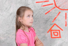 The girl on an abstract gray background. Stock Photos