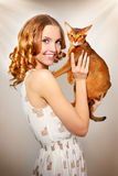 Girl with Abyssinian cat Stock Image