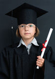 Girl in academic hat with diploma Stock Photos