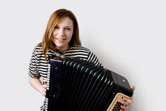 Girl with accordion Royalty Free Stock Image