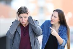 Free Girl Accusing Her Sad Friend In The Street Royalty Free Stock Images - 143612839