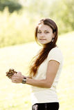 Girl with acorns Royalty Free Stock Image