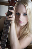 The girl with an acoustic guitar Royalty Free Stock Photos