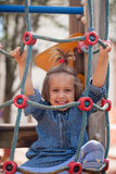 Girl at action-oriented playground Stock Images