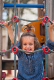 Girl at action-oriented playground Royalty Free Stock Photography