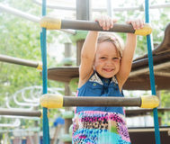 Girl at action-oriented playground Royalty Free Stock Photos