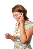 Girl activates a credit card by phone Royalty Free Stock Images