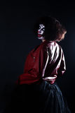 Girl actor with clown makeup in red leather jacket Royalty Free Stock Photo