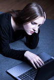 Girl addicted to computer games Stock Image