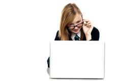 Girl adjusting her spectacles Royalty Free Stock Photography