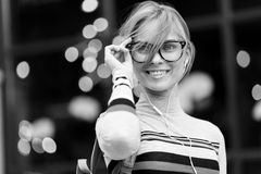 Girl adjusts his glasses , black and white photo Royalty Free Stock Photography