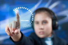 Girl adjusts the volume Royalty Free Stock Images