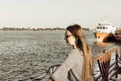 The girl admire the seascape. River harbor. The girl admire the seascape stock images
