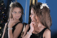 Girl admires herself in the mirror Stock Images