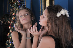 Girl admires herself in the mirror Royalty Free Stock Image