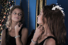 Girl admires herself in the mirror Royalty Free Stock Photo